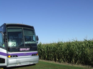Tour bus in corn field.