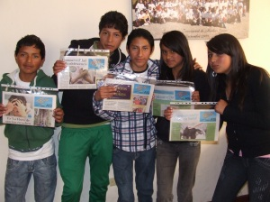 Teens showing their newspapers.