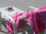 Beach chair with book, sunglasses