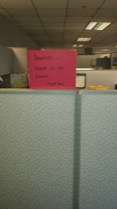 Posting a sign on your cube wall that you have a deadline may help cut down on distractions. (Photo by Cynthia Price)