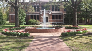 College building with fountain in front of it.